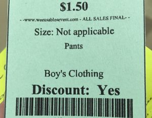 "This green tag for boy trousers has no size listed, and the only word in the two-line description is ""Pants."""