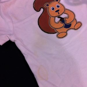 An infant onesie with several obvious stains