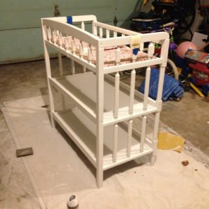 A coat of fresh spray paint took this changing table from dingy to sold.